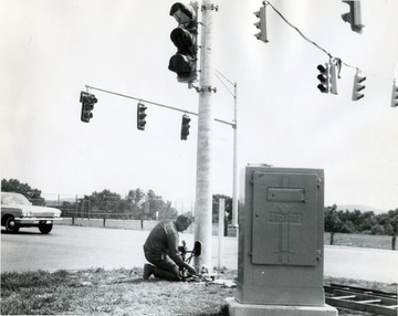 Installing traffic lights at the intersection of Patteson Drive and Monongahela Boulevard.