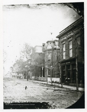 A pre-1891 picture postcard of a street, possibly Pleasant Street, in Morgantown, West Virginia.