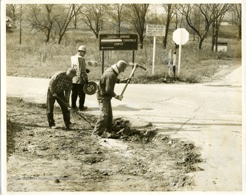 Photograph probably taken at the intersection of Burroughs Street, Van Voorhis Road, and Chestnut Ridge Road. None of the workers are identified.