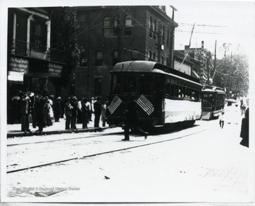 Passengers are waiting to abroad streetcars on High Street in Morgantown, West Virginia.