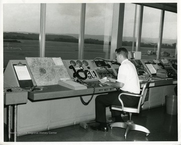 An airport employee is working at the FAA Control Station at the Morgantown, West Virginia, Morgantown, West
