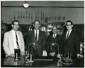 Left to right: Mr. Allamoung (?); Carroll C. Palmer, Chemistry teacher; Mr Hollandsworth; and Mr. Jenkins, Principal in a Chemistry classroom in Morgantown High School in Morgantown, W. Va.