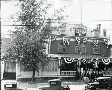 A group of men standing in front of the Elks Lodge on Walnut Street.