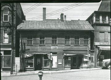 Early Frame building on Walnut Street between Dering Funeral Parlor and the Bergman building.