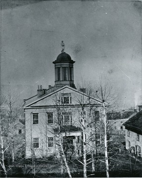 A photo of the courthouse with the statue of Patrick Henry on top.