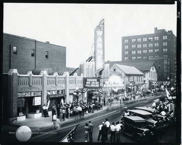 The Grand Opening at Warner Theater in October 1931 on High Street in Morgantown, West Virginia. People are standing in line to watch George Arliss in Millionaire.