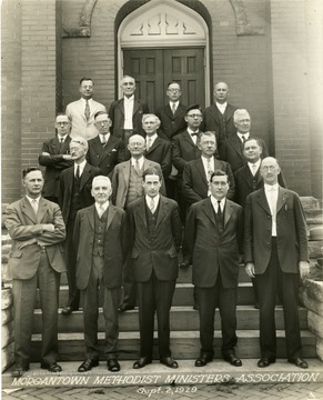 Group portrait of the Morgantown Methodist Ministers Association on the church steps.