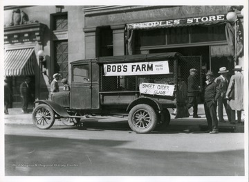 Bob's Farm Truck is parked in front of the Peoples Store on High Street in Morgantown, West Virginia.