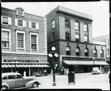 A close-up view of G. C. Murphy Company Store and Montgomery Wards stores on the east side of High Street, Morgantown, West Virginia.