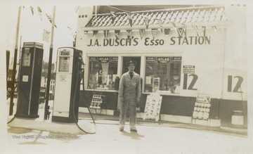 Joseph A. Dusch's Esso Service Station in Wheeling, W. Va., on corner of 33rd Eoff streets.  Includes two gas pumps and presumably J.A. Dusch standing in front of his station.
