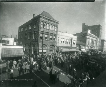 Crowds rush the Second National Bank on high street during the Depression.