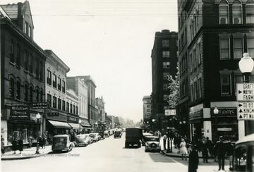 A view of High Street at the intersection of Walnut Street on a sunny day.