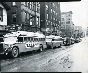 International Order of the Odd Fellows Buses in front of the Monongahela Building on High Street.