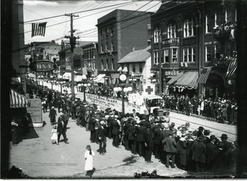 People are marching in the Liberty Bond Parade in Morgantown, West Virginia.