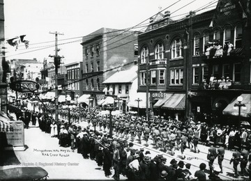 Participants are marching in the Red Cross Parade in Morgantown, West Virginia.