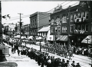 Onlookers watch marchers in the Red Cross Parade on High Street in Morgantown, West Virginia.