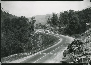 View of a car driving down Route 60 on Gauley Mountain.