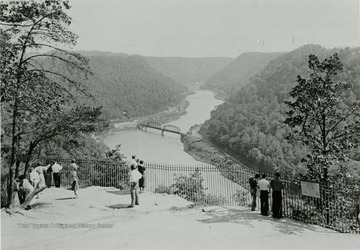 People looking at the aerial view of Hawk's Nest Rock and New River Canyon.
