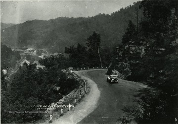 Car driving down Route 60 on Gauley Mountain.