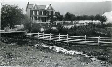 Fences line the lane to J. H. Smith's residence in Berkeley County.  Coped from an Agricultural Experiment Station glass plate negative number 1562.
