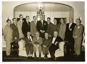 Group portrait of members of the Brooke County Bar which was taken in the William Country Club in Weirton, West Virginia. Seated left to right: Edward (Ned) George; C.K. Jacob; Judge JJ P O'Brien; and J.A. Gist. Standing left to right: James Park McMullen, Jr. Aloused C. Carman; Richard W. Barnes; Herman Rogersou; Hazlett Rodgers; R. E. Hagberg; Charles D. Bell; Clarence Spitznogle; Graham Nightingale; Walter E. Mokau; and Abraham Pruisky.