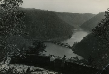 People enjoying the scenic view of the mountains and the river from Hawk's Nest in Fayette County.