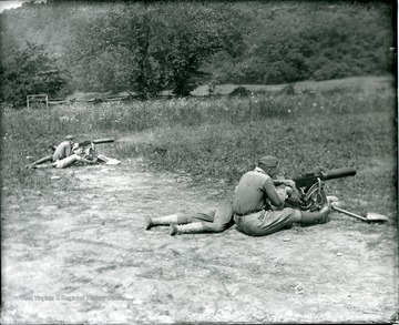 Men are participating in military training at Camp Greenbrier in Greenbrier County, West Virginia.