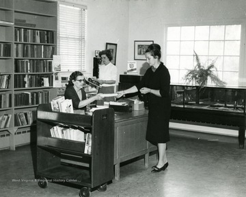 Interior of the Hardy County Public Library in Moorefield. This is one of six libraries in the United States to win the 1966 Book-of-the-Month Club Award. 'Bishoff's Studio and Camera Center, Moorefield, W. Va.'