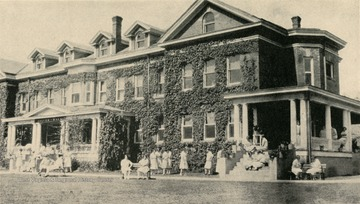 A scene of girls socializing outside of Silver Hall.