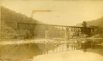 View of the Iron Bridge at Whitecomb Depot, C. and O. Railroad on a low water area of the Greenbrier River in Greenbrier County.