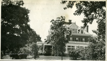 'This view is taken somehwhat to the right of the preceding one. Upon the advice of our landscape artist, the small tree in the center has been moved. Snow ball bushes are seen at the left. A sugar maple at extremem left. Notice the attractive shrubbery close to the house.'