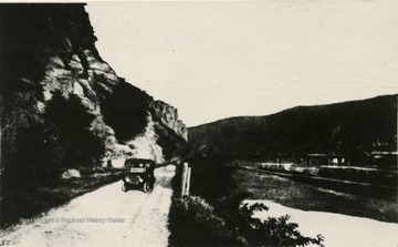 View looking down Harpers Ferry Road in Maryland, along the canal and the Potomac River. Harpers Ferry and Loudon Heights are seen in the background.