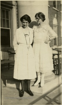 A photograph of Dr. Margaret B. Ballard and a friend standing outside.