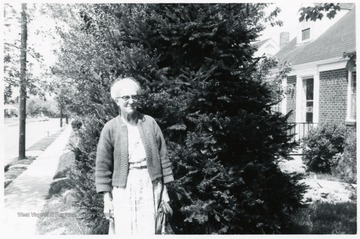 A photograph of Dr. Margaret B. Ballard standing outside in front of a tree.