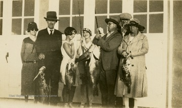 A group photo of Isaac Ballard and his family, and the fish they caught in Florida. Left to Right: 'Ma, Pop, Catherine, Jorine, Davy, Mac, Mrs. Brown.'