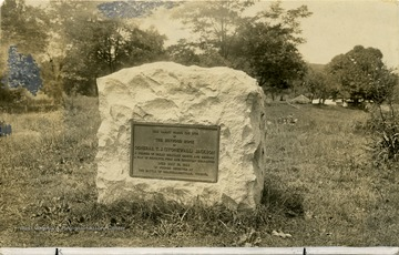 A view of a memorial stone at Jackson's Mill. It reads: 'This tablet marks the site of the boyhood home of General T. J. 'Stonewall' Jackson, a soldier of great military genius and renown, a man of resolute, pure and Christian character. Died May 10, 1863 of wounds received at the Battle of Chancellorsville, Virginia.'