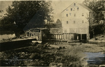 A view of Jackson's Mill with two people below the building.