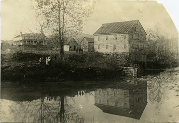 People gather by the water at Jackson's Mill.