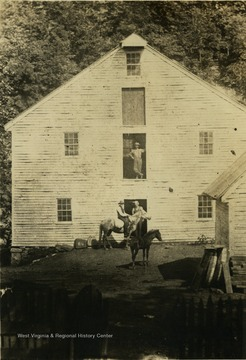 'The ravages of time. The mill in 1886 with Joseph Clifton, owner, standing in the door.'