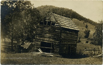 Ruins of a log house, once owned by Jesse Ellison, just before being torn down.