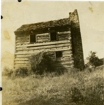A view of Jesse and Alpha Brayles Ellison house in Monroe County, West Virginia. Weaver of Woolsey-Lindsey Coverlids.