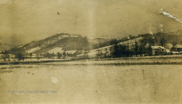 Winter view of Hans Creek Valley Included in the image are: J.E. Ellison's house before it was remodeled, the Larew barn before the big house was built. The Mill house and the mill.