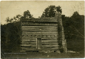 View of the early Ellison home, a split-log structure with a large flat rock chimney. John Zachariah Ellison was born there.