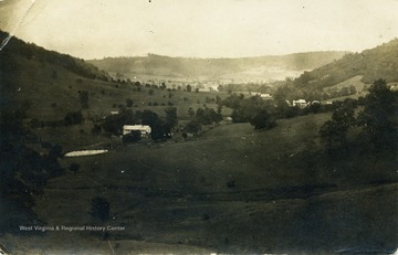 Post card photograph of the valley with John Zachariah Ellison's house is seen in the foreground.