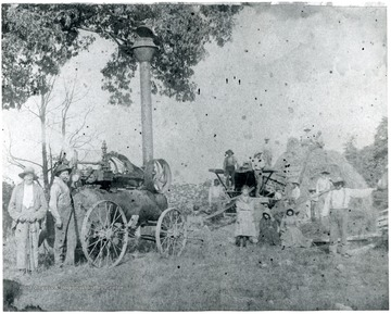Taken on James Ruddle Farm on the Buffalo Hills. In the foreground, from left to right: James Dyer Ruddle, Charley Ruddle, Maggy 'Ruddle' Hartman, Hannah ' Ruddle' Simmons, Jane Ruddle, Cora Ruddle, Clay Ruddle.