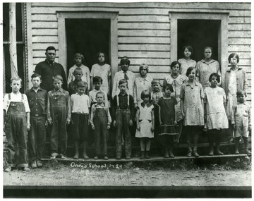 Onego School-1929.  Back Row:  Hurl Butcher (teacher), Helen Butcher, June Kisamore, Ruth Turner, Mae Huffman, Evelyn Huffman, Mabel Huffman, Kate Raines, Molly Harman (teacher).  Middle Row:  Bob Turner, Forrest Butcher, Worth Butcher.  Front Row:  Stern Butcher, Troxel Raines, Kermit Butcher, Granville Cunningham, Elvin Huffman, John Huffman, Rose Huffman, Catherine Harper, Rosalie Harper, Mabel Harper, Chester Butcher.