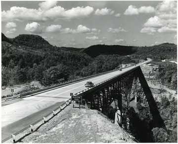 The Charlton Memorial Bridge towers 246 feet over the Bluestone Gorge.  This photo was copyrighted in 1955 by Harlow Warren of Beckley.
