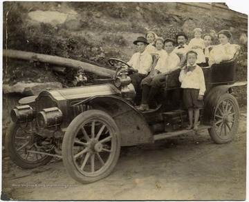'First car to Crow, W. Va. Walter Dudley and family of Glen Morgan, Permission Postmisstress at Crow. June 11, 1910