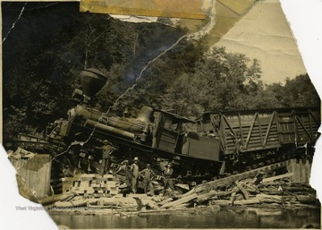 Men standing in front of the train wreck 'between Evenwood and Gladyn, W. Va. One is my brother Albert Hertry.