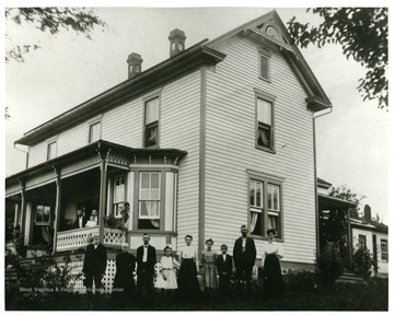 Pictured left to right:  W.C. Miller, Mrs. W.C. Miller, {John Miller, Merle Miller, Kate Miller}-one family, {Ruth Coffman (Hettinger), Tom Coffman}-Children of Cassie Coffman, Uncle Clem Miller, Aunt Sadie Miller (Boggs).  On porch:  Ed Miller, Mary Miller, Stanley Miller.